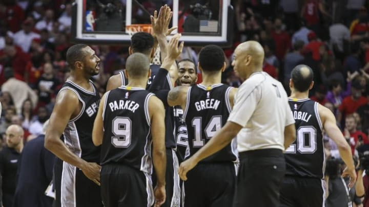Apr 10, 2015; Houston, TX, USA; San Antonio Spurs players celebrate after defeating the Houston Rockets 104-103 at Toyota Center. Mandatory Credit: Troy Taormina-USA TODAY Sports