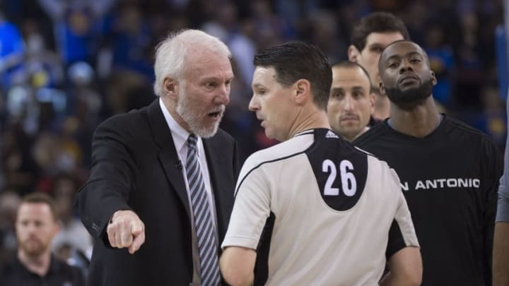 April 7, 2016; Oakland, CA, USA; San Antonio Spurs head coach Gregg Popovich (left) argues with NBA referee Pat Fraher (26) against the Golden State Warriors during the second quarter at Oracle Arena. Mandatory Credit: Kyle Terada-USA TODAY Sports