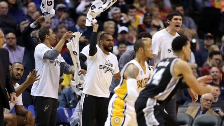 Mar 7, 2016; Indianapolis, IN, USA; San Antonio Spurs guard Patty Mills (8) cheers from the bench during a game against the Indiana Pacers at Bankers Life Fieldhouse. Indiana defeats San Antonio 99-91. Mandatory Credit: Brian Spurlock-USA TODAY Sports