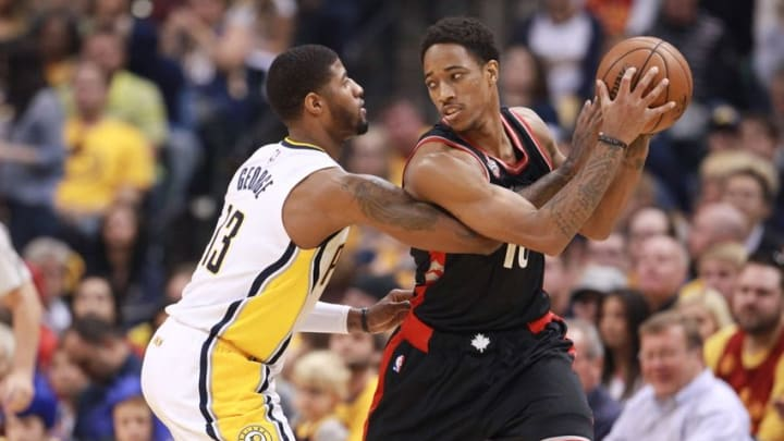 Apr 23, 2016; Indianapolis, IN, USA; Toronto Raptors forward DeMar DeRozan (10) defended by Indiana Pacers forward Paul George (13) during the first quarter in game four of the first round of the 2016 NBA Playoffs at Bankers Life Fieldhouse. Mandatory Credit: Brian Spurlock-USA TODAY Sports