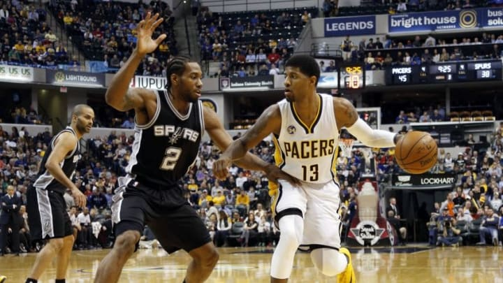 Mar 7, 2016; Indianapolis, IN, USA; Indiana Pacers forward Paul George (13) drives to the basket against San Antonio Spurs guard Kawhi Leonard (2) at Bankers Life Fieldhouse. Indiana defeats San Antonio 99-91. Mandatory Credit: Brian Spurlock-USA TODAY Sports
