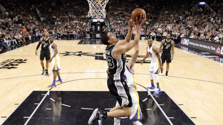 Apr 10, 2016; San Antonio, TX, USA; San Antonio Spurs guard Kevin Martin (23) shoots the ball as Golden State Warriors point guard Stephen Curry (30, behind) defends during the second half at AT&T Center. Mandatory Credit: Soobum Im-USA TODAY Sports