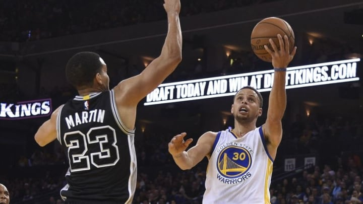 April 7, 2016; Oakland, CA, USA; Golden State Warriors guard Stephen Curry (30) shoots the basketball against San Antonio Spurs guard Kevin Martin (23) during the third quarter at Oracle Arena. The Warriors defeated the Spurs 112-101. Mandatory Credit: Kyle Terada-USA TODAY Sports
