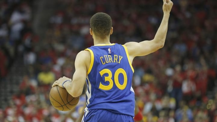Apr 24, 2016; Houston, TX, USA; Golden State Warriors guard Stephen Curry (30) dribbles against the Houston Rockets in the first half in game four of the first round of the NBA Playoffs at Toyota Center. Golden State Warriors won 121 to 94. Mandatory Credit: Thomas B. Shea-USA TODAY Sports