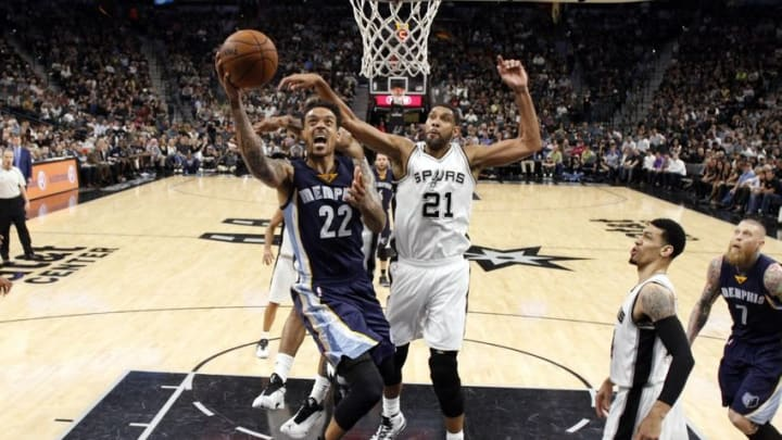 Apr 19, 2016; San Antonio, TX, USA; Memphis Grizzlies small forward Matt Barnes (22) shoots the ball past San Antonio Spurs power forward Tim Duncan (21) in game two of the first round of the NBA Playoffs at AT&T Center. Mandatory Credit: Soobum Im-USA TODAY Sports
