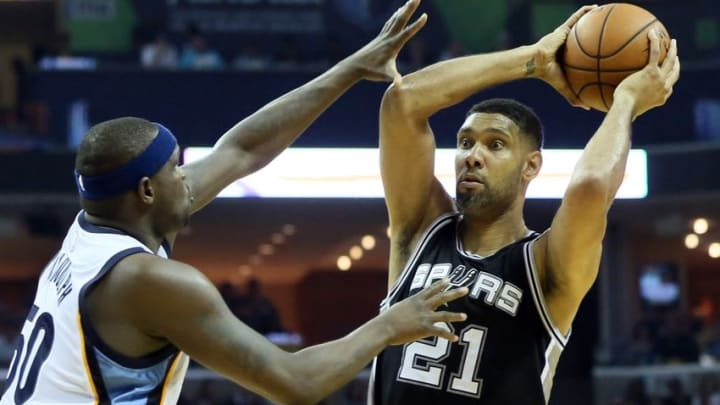 Apr 22, 2016; Memphis, TN, USA; San Antonio Spurs center Tim Duncan (21) passes as Memphis Grizzlies forward Zach Randolph (50) defends in game three of the first round of the NBA Playoffs at FedExForum. Mandatory Credit: Nelson Chenault-USA TODAY Sports