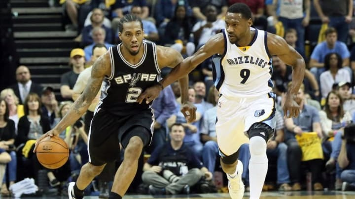 Apr 22, 2016; Memphis, TN, USA; San Antonio Spurs forward Kawhi Leonard (2) dribbles as Memphis Grizzlies guard Tony Allen (9) defends in game three of the first round of the NBA Playoffs at FedExForum. Spurs defeated Grizzlies 96-87. Mandatory Credit: Nelson Chenault-USA TODAY Sports