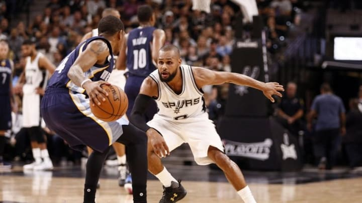 Apr 19, 2016; San Antonio, TX, USA; Memphis Grizzlies point guard Xavier Munford (14, front) dribbles the ball as San Antonio Spurs point guard Patty Mills (8, behind) defends in game two of the first round of the NBA Playoffs at AT&T Center. Mandatory Credit: Soobum Im-USA TODAY Sports