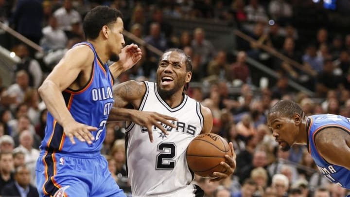 May 2, 2016; San Antonio, TX, USA; San Antonio Spurs small forward Kawhi Leonard (2) drives to the basket while guarded by Oklahoma City Thunder shooting guard Andre Roberson (21, left) in game two of the second round of the NBA Playoffs at AT&T Center. Mandatory Credit: Soobum Im-USA TODAY Sports