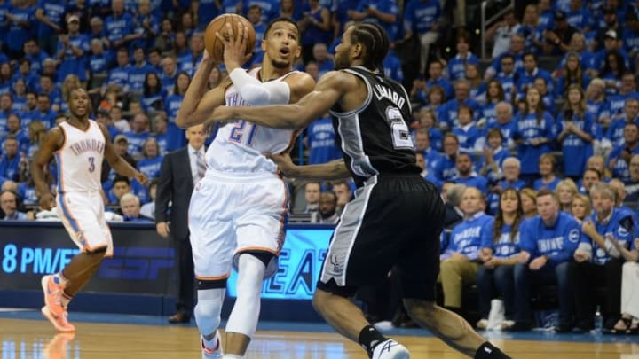 May 12, 2016; Oklahoma City, OK, USA; Oklahoma City Thunder guard Andre Roberson (21) drives to the basket in front of San Antonio Spurs forward Kawhi Leonard (2) during the third quarter in game six of the second round of the NBA Playoffs at Chesapeake Energy Arena. Mandatory Credit: Mark D. Smith-USA TODAY Sports