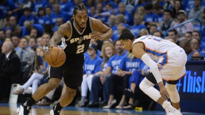 May 12, 2016; Oklahoma City, OK, USA; San Antonio Spurs forward Kawhi Leonard (2) brings the ball up the court against Oklahoma City Thunder guard Andre Roberson (21) during the first quarter in game six of the second round of the NBA Playoffs at Chesapeake Energy Arena. Mandatory Credit: Mark D. Smith-USA TODAY Sports