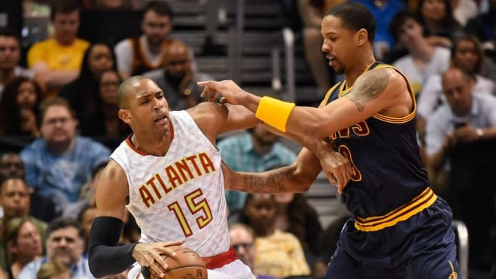 May 8, 2016; Atlanta, GA, USA; Atlanta Hawks center Al Horford (15) is fouled by Cleveland Cavaliers forward Channing Frye (9) during the second half in game four of the second round of the NBA Playoffs at Philips Arena. The Cavaliers won 100-99. Mandatory Credit: Dale Zanine-USA TODAY Sports