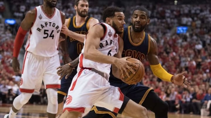May 21, 2016; Toronto, Ontario, CAN; Toronto Raptors guard Cory Joseph (6) drives to the basket as Cleveland Cavaliers guard Kyrie Irving (2) tries to defend during the second quarter in game three of the Eastern conference finals of the NBA Playoffs at Air Canada Centre. The Toronto Raptors won 99-84. Mandatory Credit: Nick Turchiaro-USA TODAY Sports