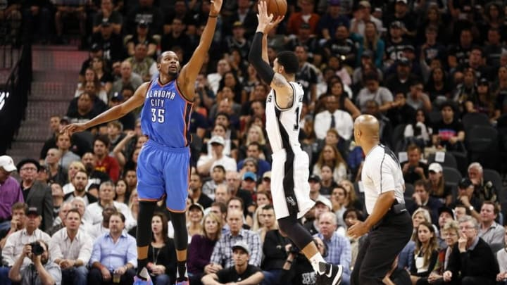 May 2, 2016; San Antonio, TX, USA; San Antonio Spurs shooting guard Danny Green (14, right) shoots the ball over Oklahoma City Thunder small forward Kevin Durant (35) in game two of the second round of the NBA Playoffs at AT&T Center. Mandatory Credit: Soobum Im-USA TODAY Sports