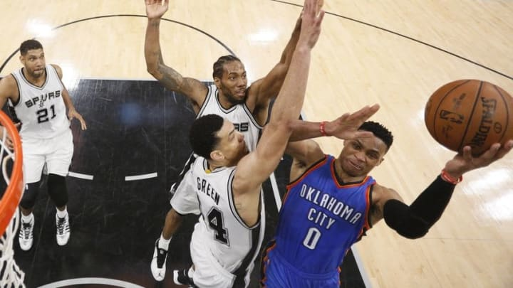 May 10, 2016; San Antonio, TX, USA; Oklahoma City Thunder point guard Russell Westbrook (0) shoots the ball as San Antonio Spurs shooting guard Danny Green (14) and Kawhi Leonard (2, behind) defend in game five of the second round of the NBA Playoffs at AT&T Center. Mandatory Credit: Soobum Im-USA TODAY Sports