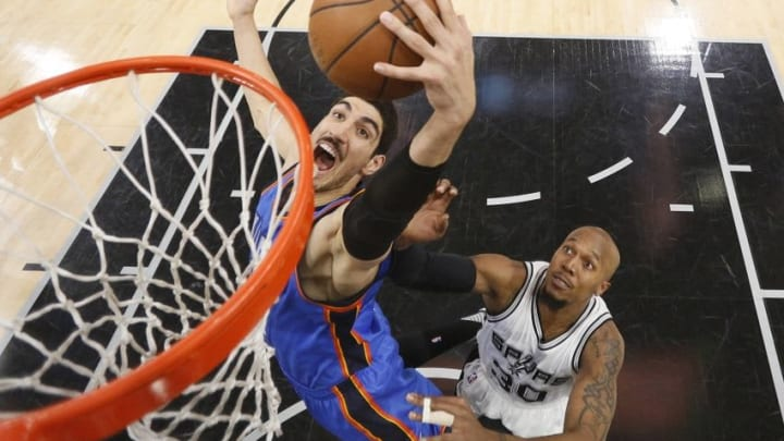 May 10, 2016; San Antonio, TX, USA; Oklahoma City Thunder center Enes Kanter (11) grabs a rebound as San Antonio Spurs power forward David West (30) defends in game five of the second round of the NBA Playoffs at AT&T Center. Mandatory Credit: Soobum Im-USA TODAY Sports