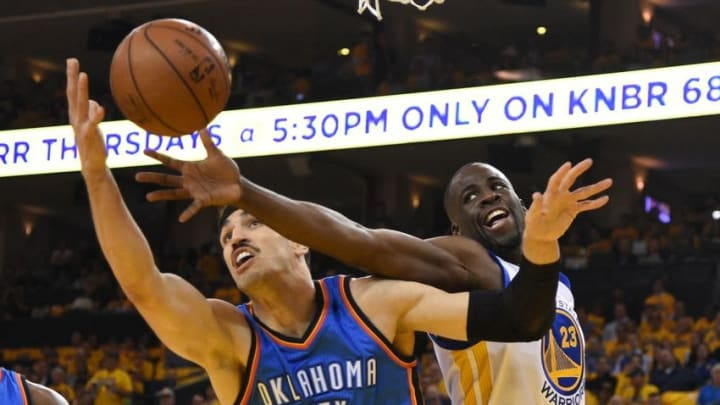 May 16, 2016; Oakland, CA, USA; Oklahoma City Thunder center Enes Kanter (11) and Golden State Warriors forward Draymond Green (23) fight for the rebound during the first quarter in game one of the Western conference finals of the NBA Playoffs at Oracle Arena. Mandatory Credit: Kyle Terada-USA TODAY Sports