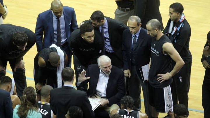 Apr 22, 2016; Memphis, TN, USA; San Antonio Spurs head coach Gregg Popovich talks to his team in game three of the first round of the NBA Playoffs at FedExForum. Mandatory Credit: Nelson Chenault-USA TODAY Sports