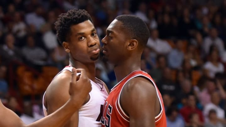 Apr 7, 2016; Miami, FL, USA; Chicago Bulls forward Bobby Portis (5) exchanges words with Miami Heat center Hassan Whiteside (21) during the first half at American Airlines Arena. Mandatory Credit: Steve Mitchell-USA TODAY Sports