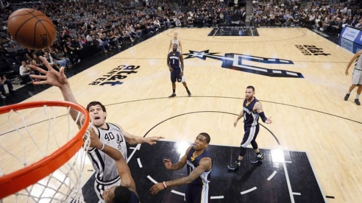 Apr 17, 2016; San Antonio, TX, USA; San Antonio Spurs center Boban Marjanovic (40) shoots the ball over Memphis Grizzlies power forward Jarell Martin (10) during the second half in game one of the first round of the NBA Playoffs at AT&T Center. Mandatory Credit: Soobum Im-USA TODAY Sports