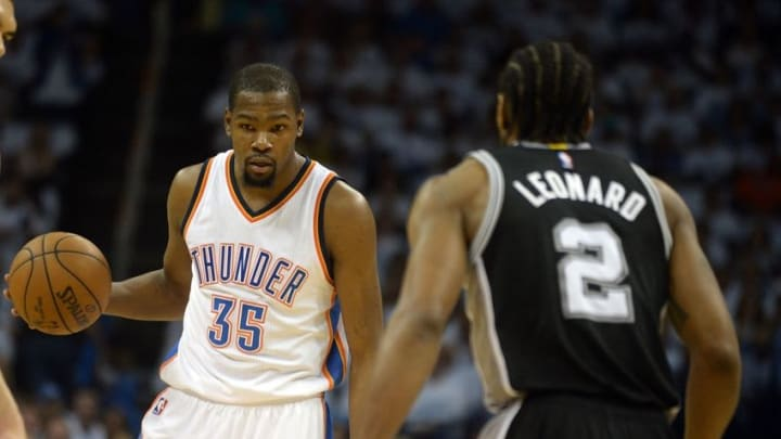May 8, 2016; Oklahoma City, OK, USA; Oklahoma City Thunder forward Kevin Durant (35) brings the ball up the court against San Antonio Spurs forward Kawhi Leonard (2) during the first quarter in game four of the second round of the NBA Playoffs at Chesapeake Energy Arena. Mandatory Credit: Mark D. Smith-USA TODAY Sports