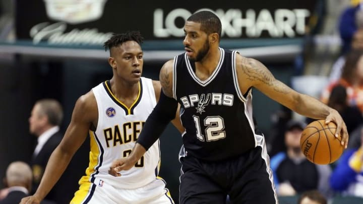 Mar 7, 2016; Indianapolis, IN, USA; San Antonio Spurs forward LaMarcus Aldridge (12) is guarded by Indiana Pacers center Myles Turner (33) at Bankers Life Fieldhouse. Indiana defeats San Antonio 99-91. Mandatory Credit: Brian Spurlock-USA TODAY Sports