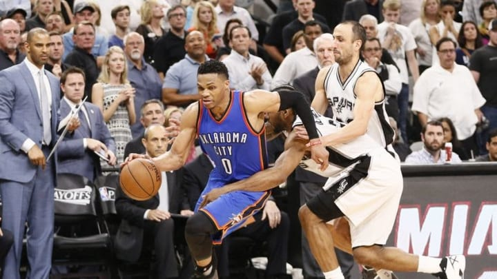 May 10, 2016; San Antonio, TX, USA; Oklahoma City Thunder point guard Russell Westbrook (0) drives to the basket past San Antonio Spurs small forward Kawhi Leonard (2) in game five of the second round of the NBA Playoffs at AT&T Center. Mandatory Credit: Soobum Im-USA TODAY Sports