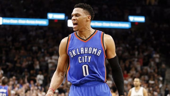 May 10, 2016; San Antonio, TX, USA; Oklahoma City Thunder point guard Russell Westbrook (0) celebrates a basket and a foul against the San Antonio Spurs after scoring in game five of the second round of the NBA Playoffs at AT&T Center. Mandatory Credit: Soobum Im-USA TODAY Sports