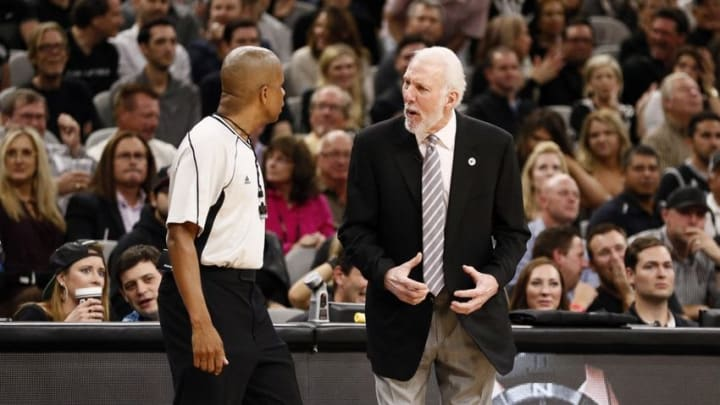May 2, 2016; San Antonio, TX, USA; San Antonio Spurs head coach Gregg Popovich argues a call with referee Sean Corbin (33) in game two of the second round of the NBA Playoffs against the Oklahoma City Thunder at AT&T Center. Mandatory Credit: Soobum Im-USA TODAY Sports