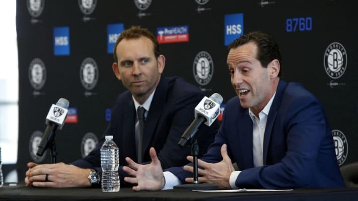 May 16, 2016; Brooklyn, NY, USA; Brooklyn Nets general manager Sean Marks listens to Brooklyn Nets new head coach Kenny Atkinson answer questions from media during press conference at HSS Training Center. Mandatory Credit: Noah K. Murray-USA TODAY Sports