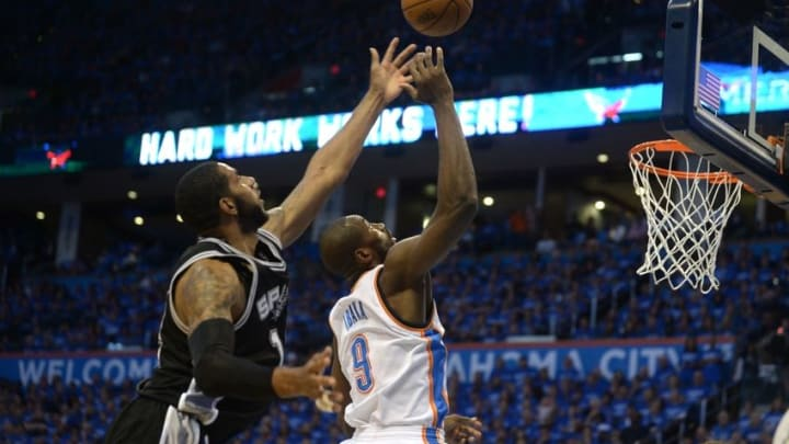 May 12, 2016; Oklahoma City, OK, USA; Oklahoma City Thunder forward Serge Ibaka (9) blocks a shot attempt by San Antonio Spurs forward LaMarcus Aldridge (12) during the second quarter in game six of the second round of the NBA Playoffs at Chesapeake Energy Arena. Mandatory Credit: Mark D. Smith-USA TODAY Sports