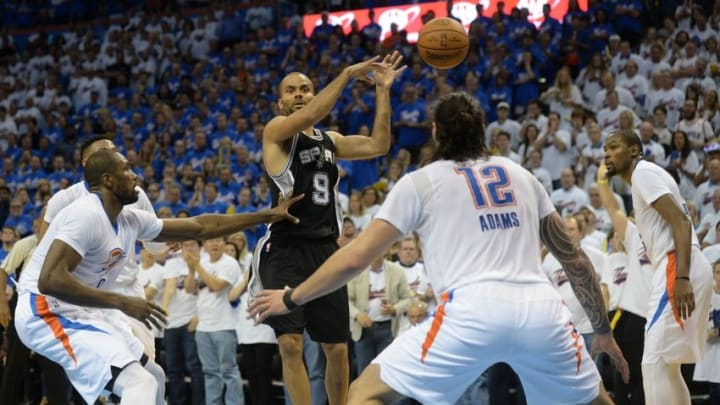 May 6, 2016; Oklahoma City, OK, USA; San Antonio Spurs guard Tony Parker (9) passes the ball while guarded by Oklahoma City Thunder forward Serge Ibaka (9) during the fourth quarter in game three of the second round of the NBA Playoffs at Chesapeake Energy Arena. Mandatory Credit: Mark D. Smith-USA TODAY Sports