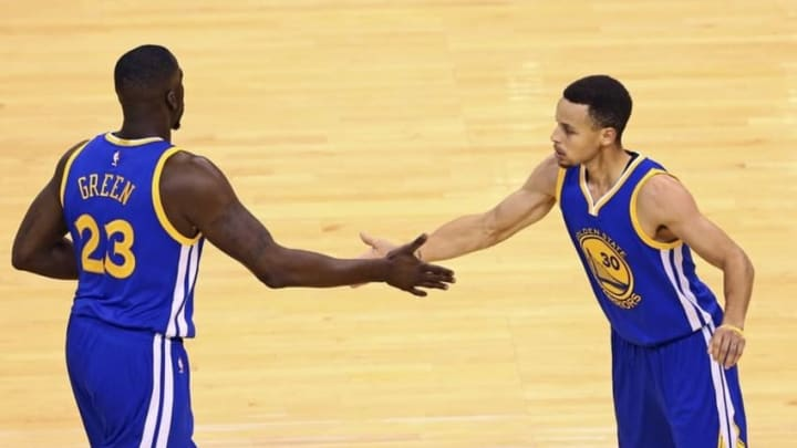 May 22, 2016; Oklahoma City, OK, USA; Golden State Warriors forward Draymond Green (23) and guard Stephen Curry (30) celebrate during the third quarter against the Oklahoma City Thunder during the first quarter in game three of the Western conference finals of the NBA Playoffs at Chesapeake Energy Arena. Mandatory Credit: Kevin Jairaj-USA TODAY Sports