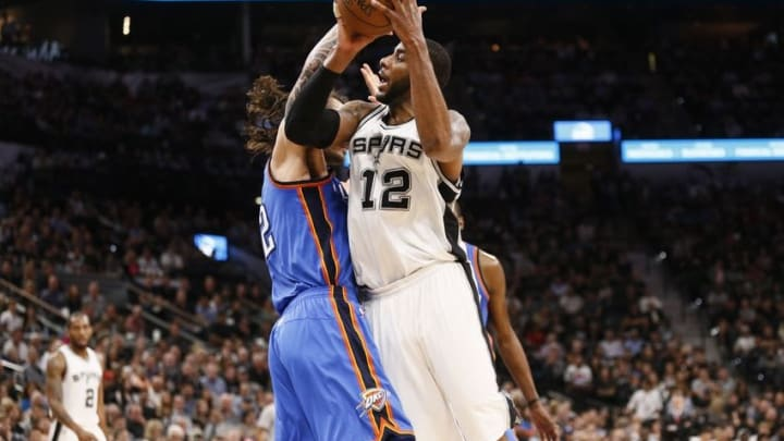 May 2, 2016; San Antonio, TX, USA; San Antonio Spurs power forward LaMarcus Aldridge (12) is fouled while shooting by Oklahoma City Thunder center Steven Adams (12, left) in game two of the second round of the NBA Playoffs at AT&T Center. Mandatory Credit: Soobum Im-USA TODAY Sports