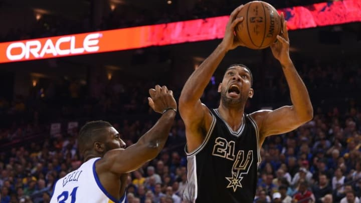 April 7, 2016; Oakland, CA, USA; San Antonio Spurs center Tim Duncan (21) shoots the basketball against Golden State Warriors center Festus Ezeli (31) during the first quarter at Oracle Arena. Mandatory Credit: Kyle Terada-USA TODAY Sports