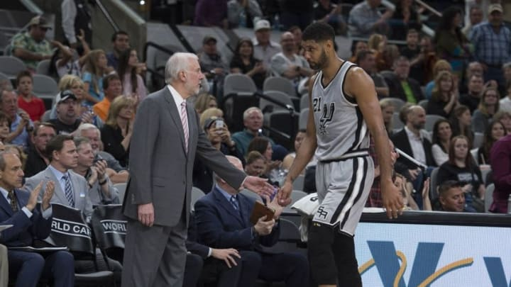 Apr 2, 2016; San Antonio, TX, USA; San Antonio Spurs head coach Gregg Popovich greets center Tim Duncan (21) as Duncan leaves the game during the second half against the Toronto Raptors at the AT&T Center. The Spurs defeat the Raptors 102-95. Mandatory Credit: Jerome Miron-USA TODAY Sports