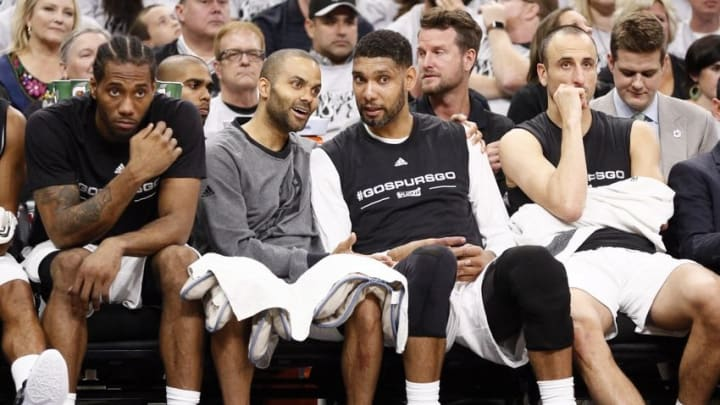 Apr 30, 2016; San Antonio, TX, USA; San Antonio Spurs players (from left to right) Kawhi Leonard, and Tony Parker, and Tim Duncan, and Manu Ginobili (20) watch on the bench against the Oklahoma City Thunder in game one of the second round of the NBA Playoffs at AT&T Center. Mandatory Credit: Soobum Im-USA TODAY Sports