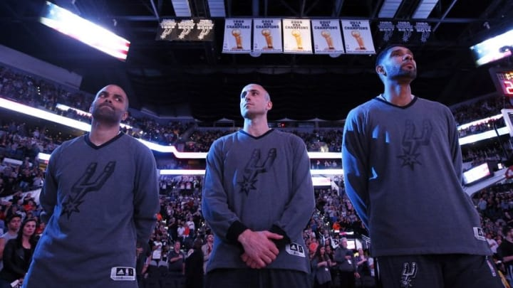 Mar 25, 2016; San Antonio, TX, USA; San Antonio Spurs forward Tim Duncan (R), guard Manu Ginobili (C), and guard Tony Parker (L) stand for the national anthem before the game against the Memphis Grizzlies at AT&T Center. Mandatory Credit: Soobum Im-USA TODAY Sports