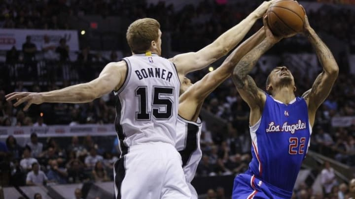 Apr 26, 2015; San Antonio, TX, USA; Los Angeles Clippers small forward Matt Barnes (22) has his shot blocked by San Antonio Spurs power forward Matt Bonner (15) and Tim Duncan (behind) in game four of the first round of the NBA Playoffs at AT&T Center. Mandatory Credit: Soobum Im-USA TODAY Sports