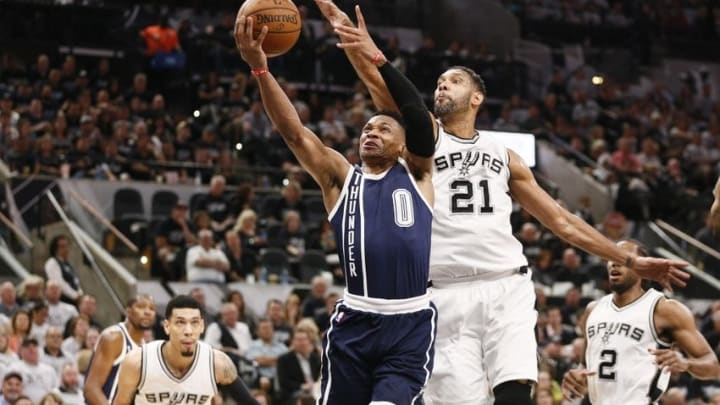 Apr 30, 2016; San Antonio, TX, USA; Oklahoma City Thunder point guard Russell Westbrook (0) has his shot blocked by San Antonio Spurs power forward Tim Duncan (21) in game one of the second round of the NBA Playoffs at AT&T Center. Mandatory Credit: Soobum Im-USA TODAY Sports