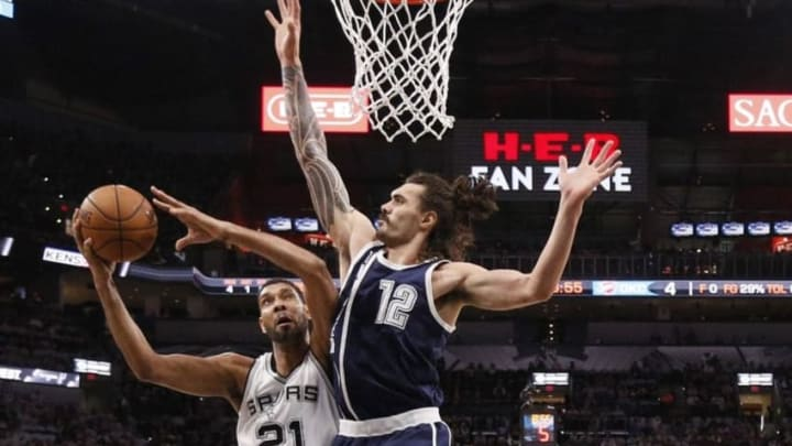 Apr 30, 2016; San Antonio, TX, USA; San Antonio Spurs power forward Tim Duncan (21) shoots the ball as Oklahoma City Thunder center Steven Adams (12) defends in game one of the second round of the NBA Playoffs at AT&T Center. Mandatory Credit: Soobum Im-USA TODAY Sports