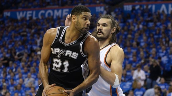 May 12, 2016; Oklahoma City, OK, USA; San Antonio Spurs center Tim Duncan (21) fights for position with Oklahoma City Thunder center Steven Adams (12) during the first quarter in game six of the second round of the NBA Playoffs at Chesapeake Energy Arena. Mandatory Credit: Mark D. Smith-USA TODAY Sports