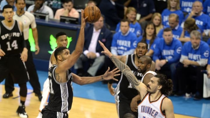 May 12, 2016; Oklahoma City, OK, USA; San Antonio Spurs center Tim Duncan (21) shoots the ball over Oklahoma City Thunder center Steven Adams (12) during the second quarter in game six of the second round of the NBA Playoffs at Chesapeake Energy Arena. Mandatory Credit: Mark D. Smith-USA TODAY Sports