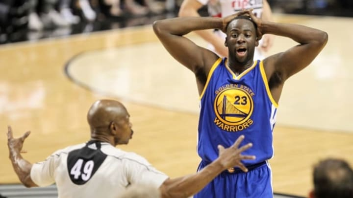 May 9, 2016; Portland, OR, USA; Golden State Warriors forward Draymond Green (23) reacts after referee Tom Washington (49) makes a call in game four of the second round of the NBA Playoffs against the Portland Trail Blazers at Moda Center at the Rose Quarter. Mandatory Credit: Jaime Valdez-USA TODAY Sports