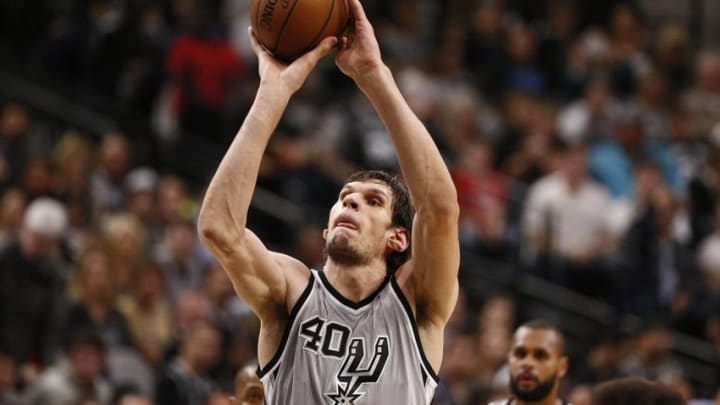 Dec 26, 2015; San Antonio, TX, USA; San Antonio Spurs center Boban Marjanovic (40) shoots a free throw against the Denver Nuggets during the first half at AT&T Center. Mandatory Credit: Soobum Im-USA TODAY Sports