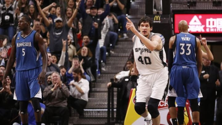 Dec 28, 2015; San Antonio, TX, USA; San Antonio Spurs center Boban Marjanovic (40) reacts after scoring against the Minnesota Timberwolves during the second half at AT&T Center. Mandatory Credit: Soobum Im-USA TODAY Sports