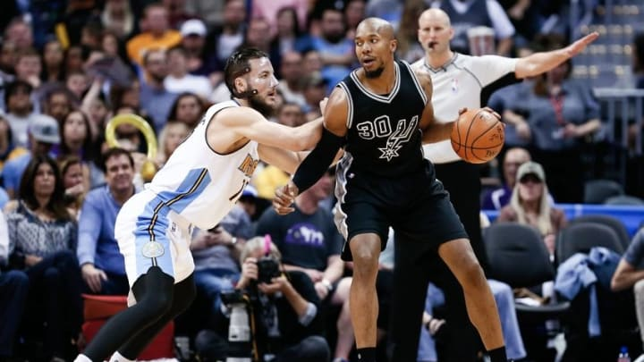 Apr 8, 2016; Denver, CO, USA; Denver Nuggets center Joffrey Lauvergne (77) defends against San Antonio Spurs forward David West (30) in the third quarter at the Pepsi Center. The Nuggets defeated the Spurs 102-98. Mandatory Credit: Isaiah J. Downing-USA TODAY Sports