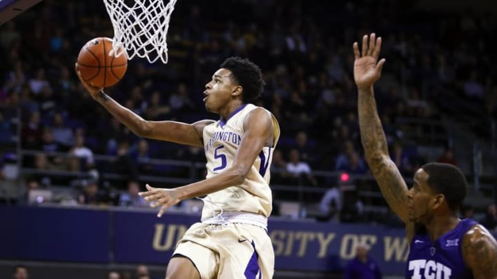 Dec 8, 2015; Seattle, WA, USA; Washington Huskies guard Dejounte Murray (5) shoots a layup against the TCU Horned Frogs during the first half at Alaska Airlines Arena. Mandatory Credit: Joe Nicholson-USA TODAY Sports