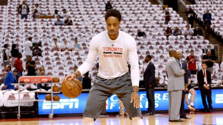 May 23, 2016; Toronto, Ontario, CAN; Toronto Raptors guard DeMar DeRozan (10) dribbles a pair of basketballs prior to playing Cleveland Cavaliers in game four of the Eastern conference finals of the NBA Playoffs at Air Canada Centre. Mandatory Credit: Dan Hamilton-USA TODAY Sports