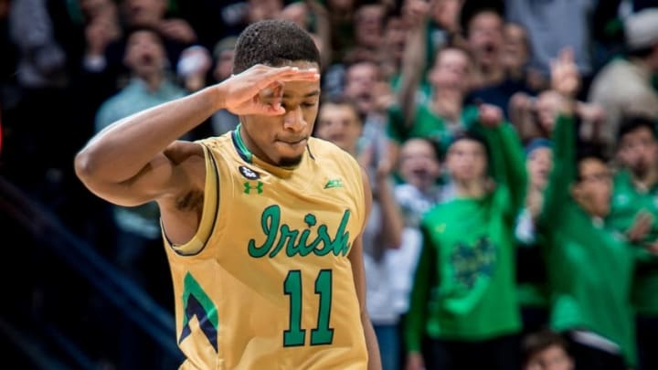 Feb 13, 2016; South Bend, IN, USA; Notre Dame Fighting Irish guard Demetrius Jackson (11) celebrates after a three point basket in the second half against the Louisville Cardinals at the Purcell Pavilion. Notre Dame won 71-66. Mandatory Credit: Matt Cashore-USA TODAY Sports